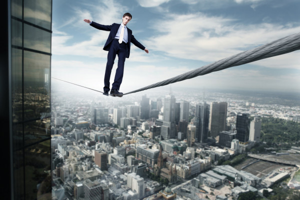Business-man-balancing-on-the-rope-high-in-the-sky-600x400
